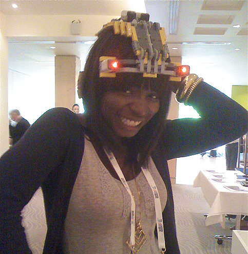 Photo of Oyin wearing a hat made of lego